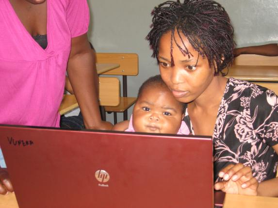 Learning to use a computer in Inhambane, Mozambique